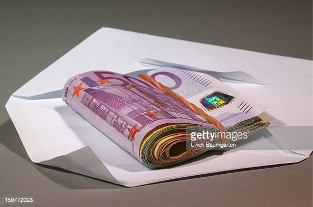 Bundled euronote in a envelope Symbol picture about bribery black money