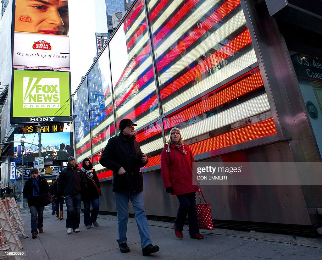 Bundled up pedestrians walk through Times Square January 23, 2013 in New York. Two-thirds of the US was in the grips of a blast of cold Arctic air Wednesday with temperatures falling to some of the lowest marks in years and wind chills plummeting to dangerously low levels.