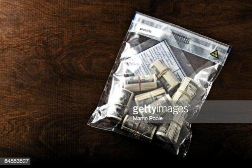 bundles of 100 dollar bills in police evidence
