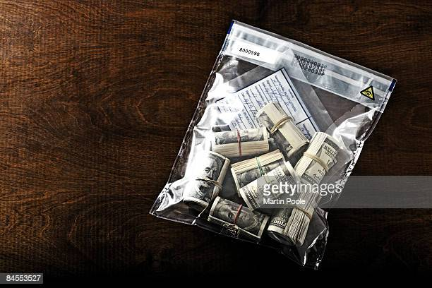 bundles of 100 dollar bills in police evidence