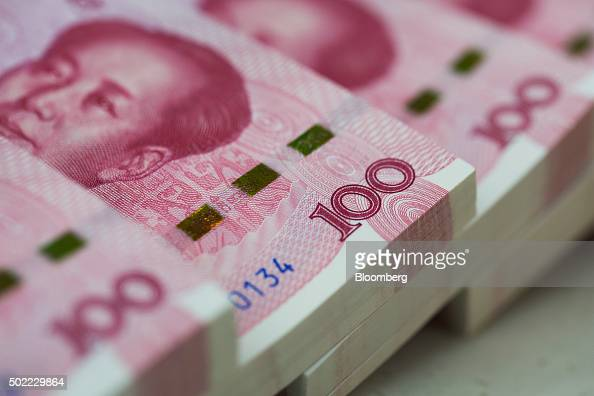 Bundles of Chinese onehundred yuan banknotes are arranged for a photograph at the Counterfeit Notes Response Center of KEB Hana Bank in Seoul South...