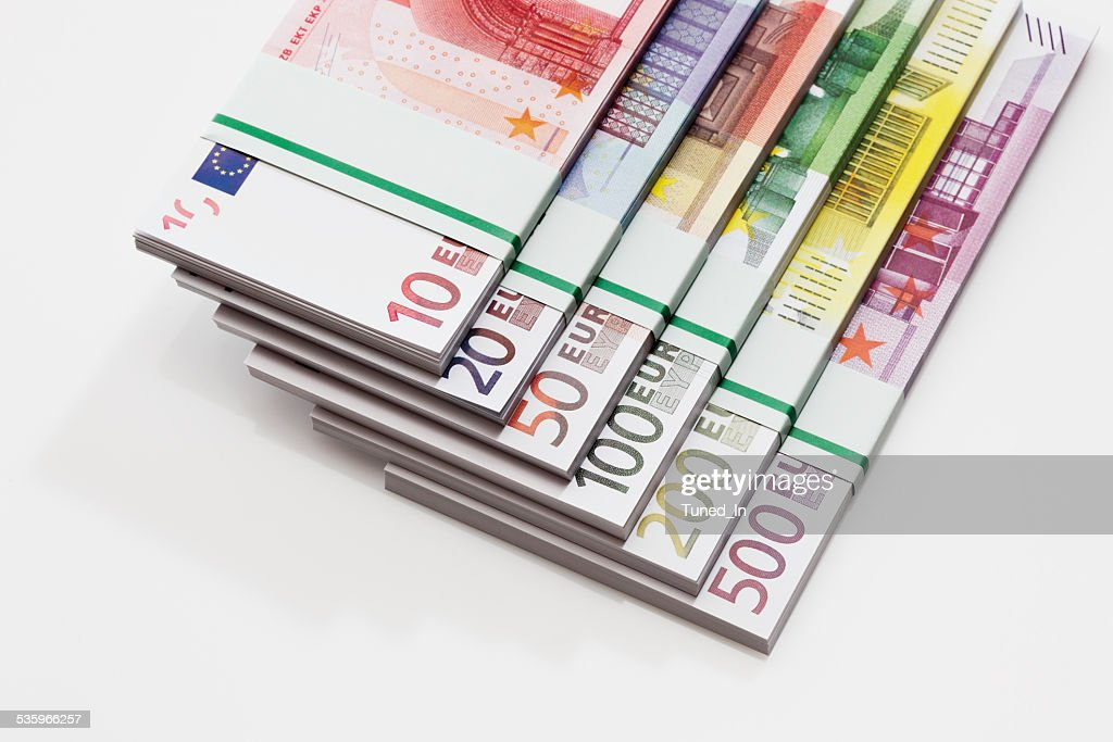Bundles of Euro banknotes on white background, close-up : Stock Photo