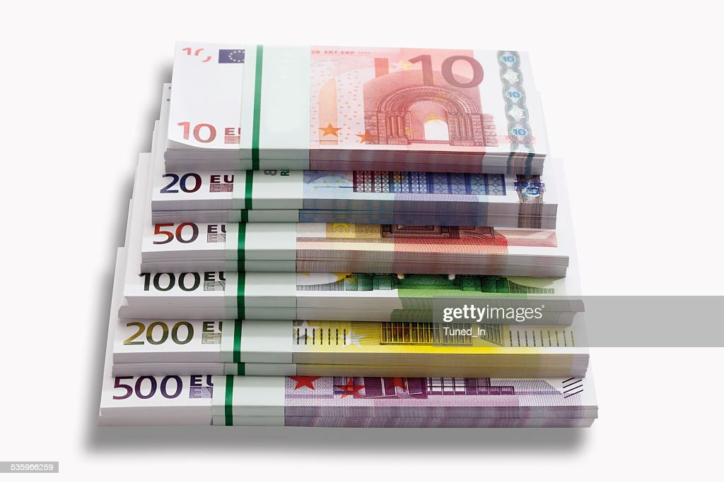 Bundles of Euro banknotes on white background, close-up : Stock Photo