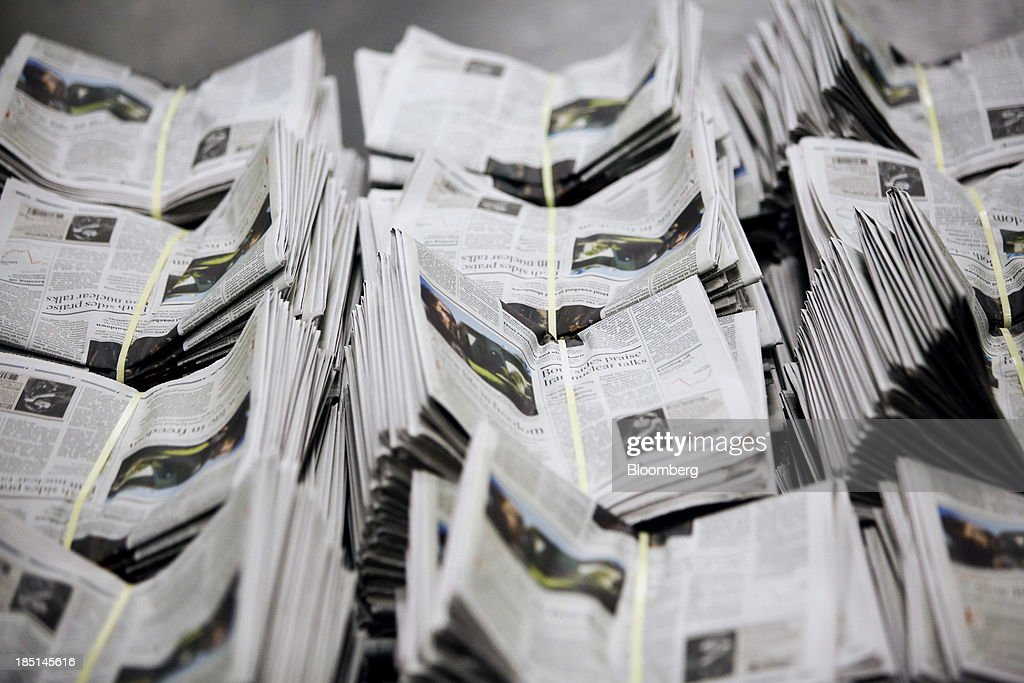 Bundles of Los Angeles Times newspapers wait to be distributed at the Olympic Press facility in Los Angeles, California, U.S, on Wednesday, Oct. 16, 2013. Congress ended the 16-day government shutdown, raising the U.S. debt limit after the leaders of the Senate reached a bipartisan agreement to end the nation's fiscal impasse. Photographer: Patrick T. Fallon/Bloomberg via Getty Images