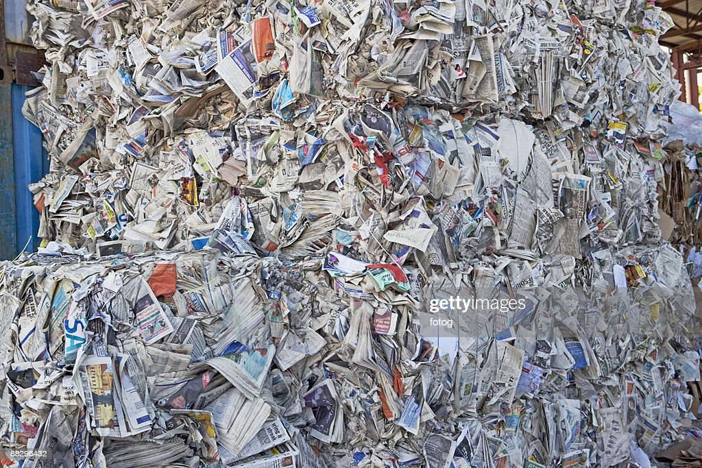 Bundles of paper at recycling plant : Stock Photo