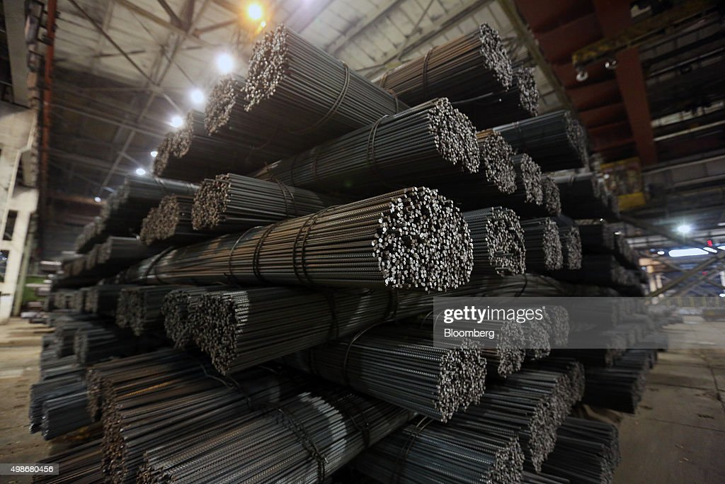 Bundles of steel reinforcement rods sit in a storage area in the rolling shop at the Evraz Consolidated WestSiberian Metallurgical Plant operated by...