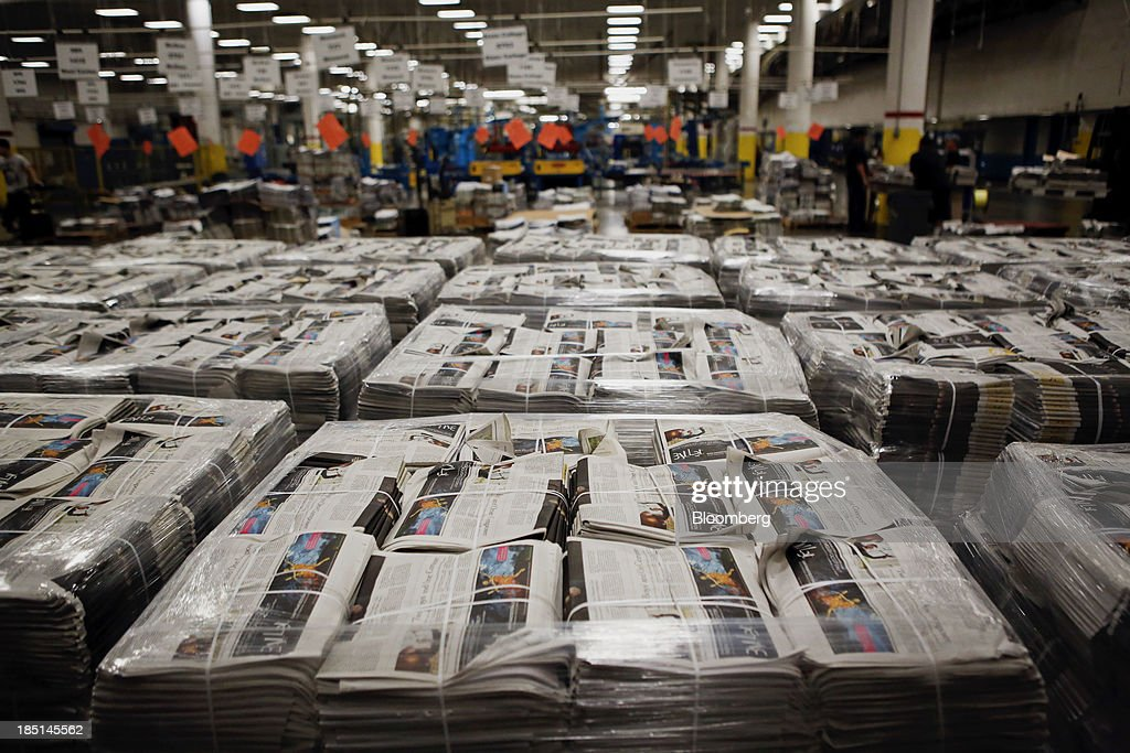 Bundles of various newspapers are wrapped in pallets at the Los Angeles Times Olympic Press facility in Los Angeles, California, U.S, on Wednesday, Oct. 16, 2013. Congress ended the 16-day government shutdown, raising the U.S. debt limit after the leaders of the Senate reached a bipartisan agreement to end the nation's fiscal impasse. Photographer: Patrick T. Fallon/Bloomberg via Getty Images