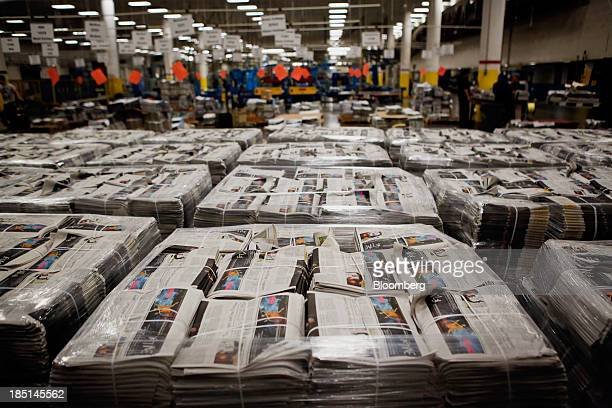Bundles of various newspapers are wrapped in pallets at the Los Angeles Times Olympic Press facility in Los Angeles California US on Wednesday Oct 16...