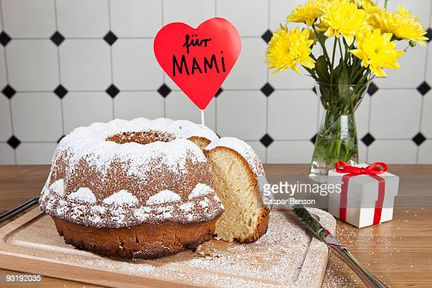 A Bundt cake, flowers and a gift box for Mother's Day in Germany