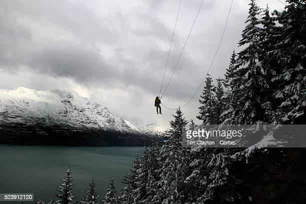 A bungy jumper gets a birds eye view of fresh snow falls in Queenstown New ZealandQueenstown is nestled on the shores of the crystal clear waters of...