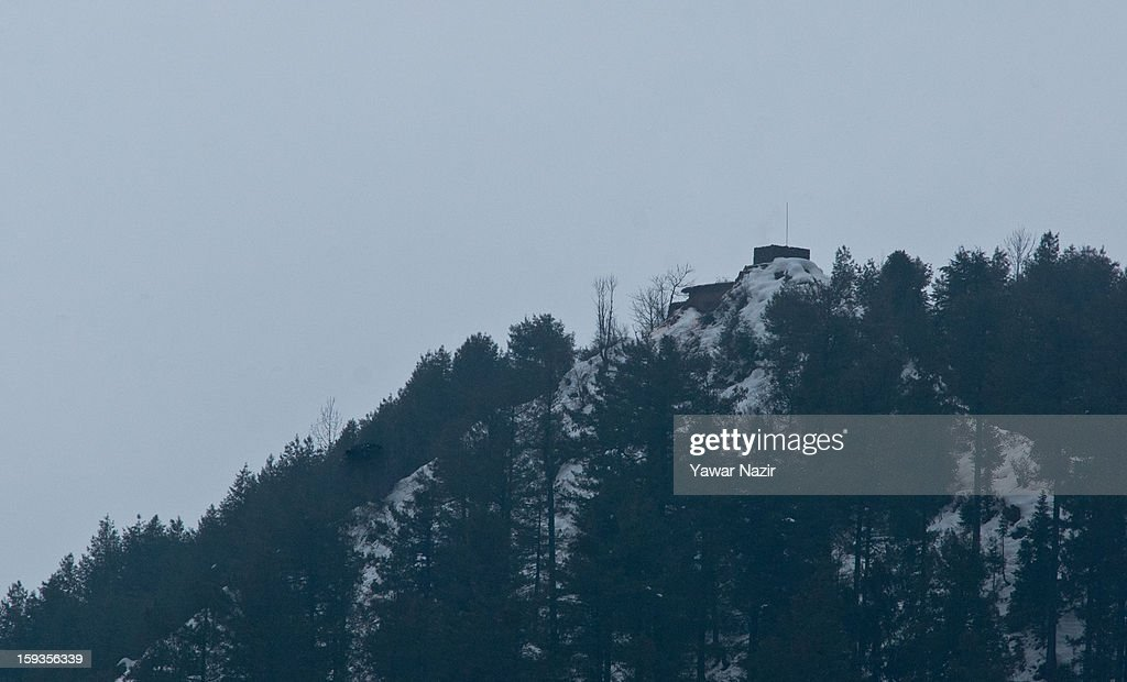 A bunker is seen on the Pakistan administered side of Kashmir from Churunda village on January 12, 2013, northwest of Srinagar, the summer capital of Indian Administered Kashshmir, India. The village with a population of a little over 12,000 people has been bearing the brunt of cross-fire between nuclear rivals India and Pakistan. Last week a Pakistan solider was killed across the Line of Control (LOC), a military line that divides Indian-administered Kashmir from the Pakistan-administered Kashmir at this village. People living along the LoC have continually been at risk due to hostility between the armies of the two rival nations. Last year, in November, three people, including a pregnant woman, had died after a shell fired from Pakistan landed on one of the houses in the village. Tension between Pakistan and India has escalated after a fresh skimirish along the border. Both countries have summoned each other's envoy to protest against unacceptable and unprovoked' attacks.