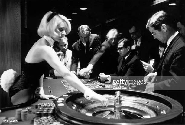 A Bunny Girl croupier spins the roulette wheel in the casino at London's Playboy Club 20th December 1967