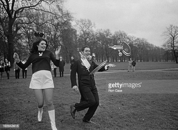 Bunny Girl Elaine Tully of the Playboy Club and John Romano of the Grosvenor House Hotel collide and drop their trays during practice in Hyde Park...