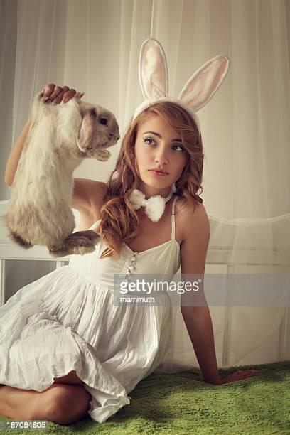 bunny girl holding a rabbit