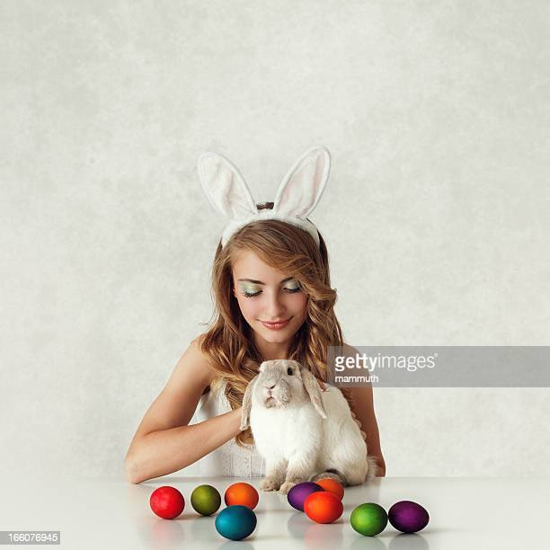 bunny girl with baby rabbit and easter eggs