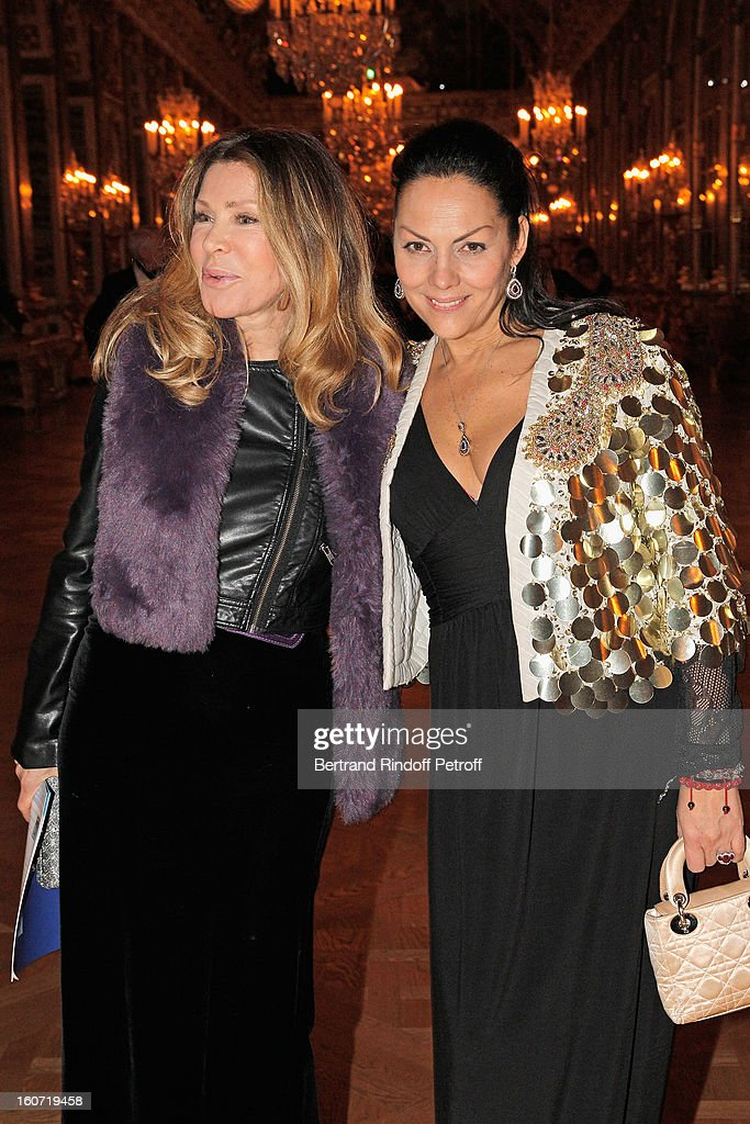Bunny Godillot (L) and Princess Hermine de Clermont Tonnerre pose in the Hall of Mirrors as they attend the gala dinner of Professor David Khayat's association 'AVEC', at Chateau de Versailles on February 4, 2013 in Versailles, France.