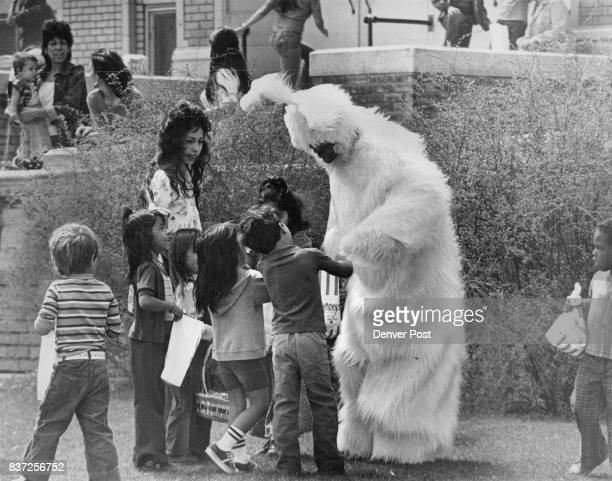 APR 12 1976 APR 14 1976 'Bunny' greets young admirers at Easter egg hunt Bernard Lopez a West High School teacher portraying tall furry Easter bunny...