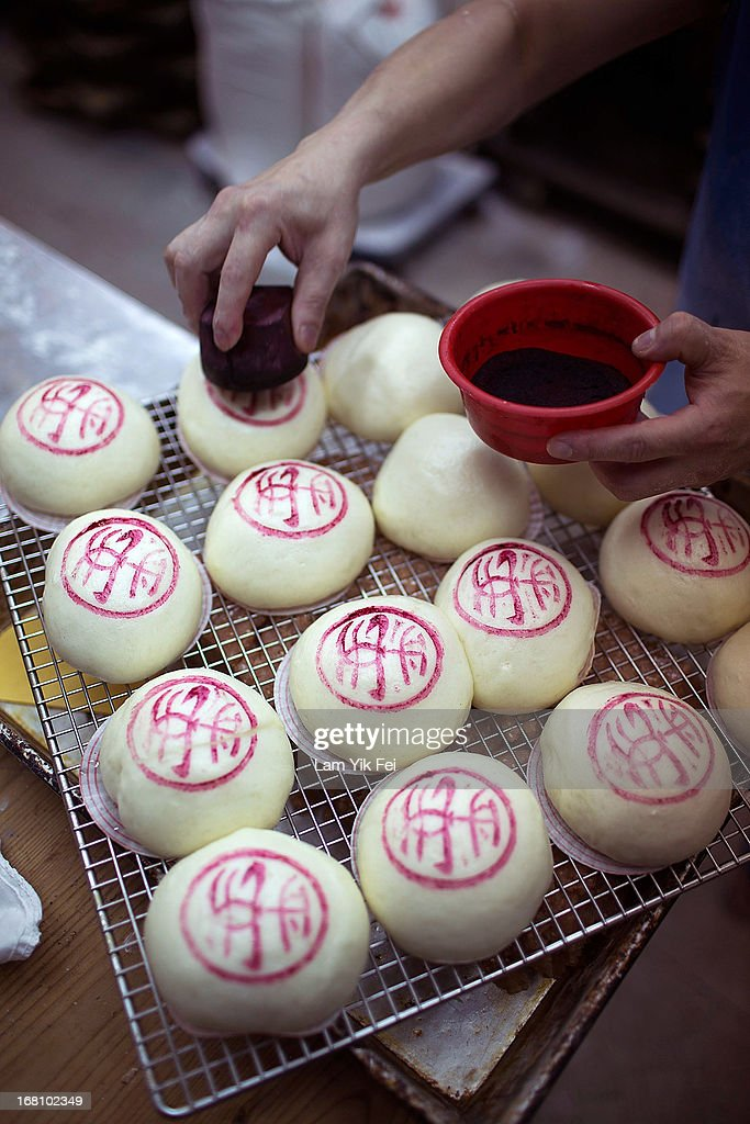 Buns are stamped inside a bakery during the selection contest for the finalists of the Cheung Chau Bun Scrambling Competition in Cheung Chau, Hong Kong. The Cheung Chau Bun scrambling Competition is a part of Tai Ping Qing Jiao Festival. the Purest Sacrifice celebrated for Great Peace and the day of festivitie ends with guests climbing 20-metre bamboo towers to retrieve 'lucky' buns dotted up their length.