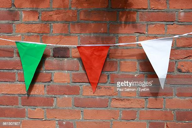 Bunting Against Brick Wall