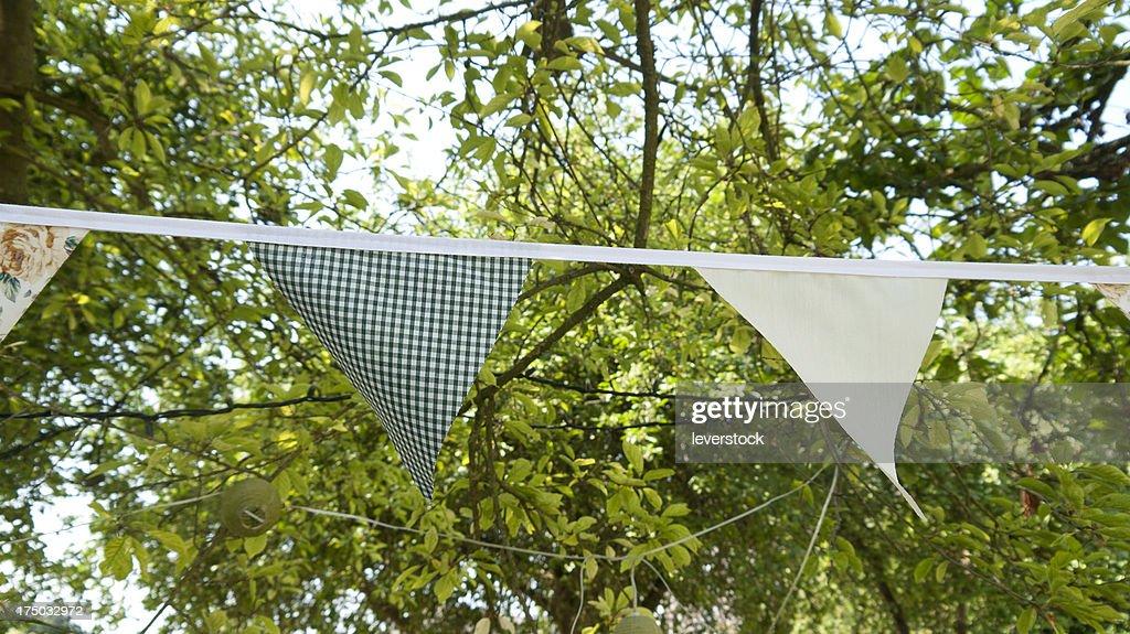 bunting hanging in a garden in summer