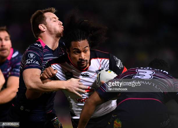 Bunty Afoa of the Warriors is tackled by Michael Morgan and Justin O'Neil of the Cowboys during the round 20 NRL match between the North Queensland...