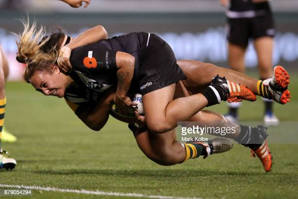 Bunty KuruwakaCrowe of the Kiwi Ferns is tackled by Maima Taufu of the Jillaroos during the women's ANZAC Test match between the Australian Jillaroos...