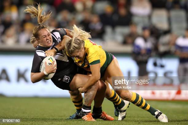 Bunty KuruwakaCrowe of the Kiwi Ferns is tackled by Rebecca Young and Ruan Sims of the Jillaroos during the women's ANZAC Test match between the...