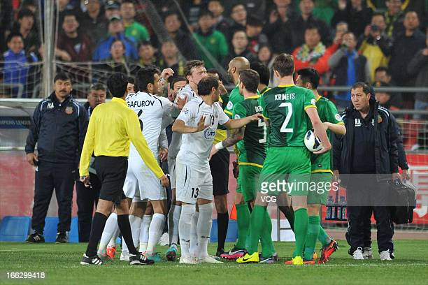 Bunyodkor players argue with Beijing Guoan players during the AFC Champions League Group match between Beijing Guoan and Bunyodkor at Beijing...