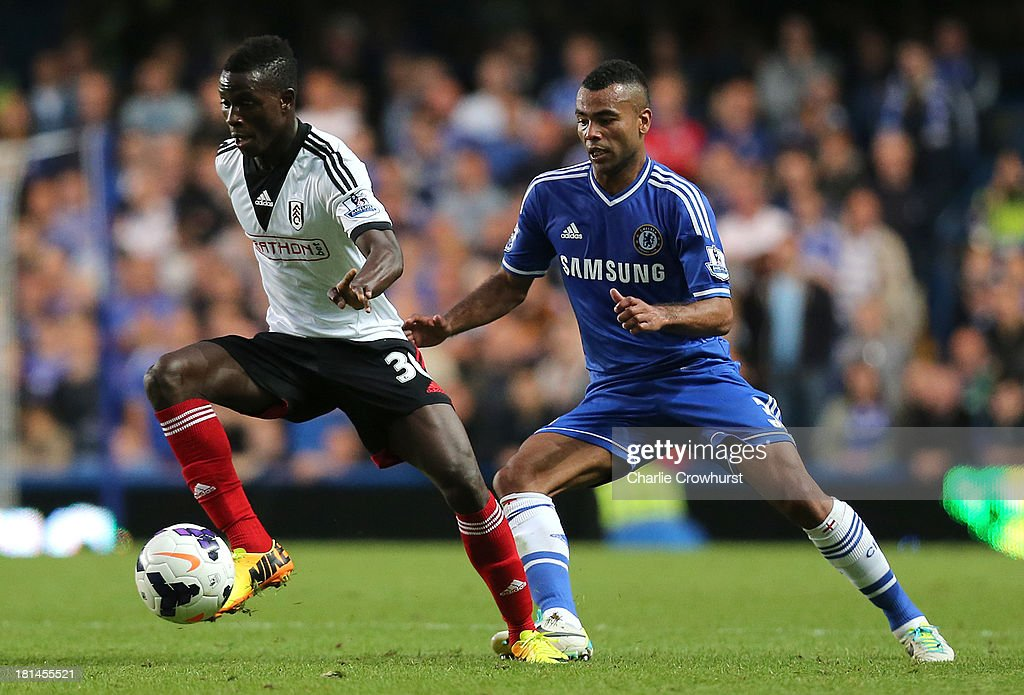 Buomesca Tue Na Bangna of Fulham looks to turn Ashley Cole of Chelsea during the Barclays Premier League match between Chelsea and Fulham at Stamford Bridge on September 21, 2013 in London, England.