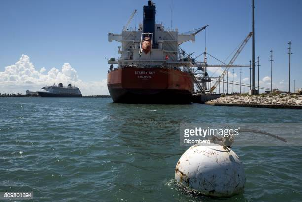 A buoy floats in front of the Starry Sky bulk carrier ship at Port Canaveral in Cape Canaveral Florida US on Wednesday July 5 2017 The US Census...