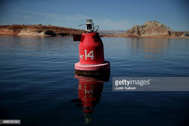 A buoy floats in the waters of Lake Powell on March 29 2015 in Lake Powell Utah As severe drought grips parts of the Western United States a below...