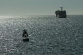 A buoy floats on the sea after it was maintained by workers and put into use on June 10 2005 in Haikou of Hainan Province southern China Local...