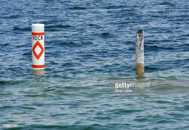A buoy marks a recently exposed hazard jutting out above the surface of Lake Mead posing a risk to boaters on July 30 2007 in the Lake Mead National...