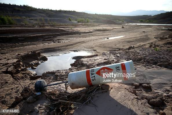 A buoy sits next to a puddle at the now closed Echo Bay Marina on May 12 2015 in Lake Mead National Recreation Area Nevada As severe drought grips...