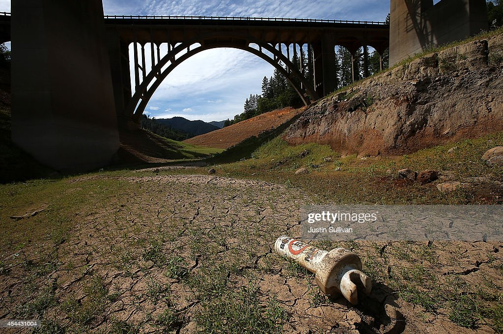 A buoy sits on dry cracked earth on a dry inlet of Shasta Lake on August 30 2014 in Lakehead California As the severe drought in California continues...