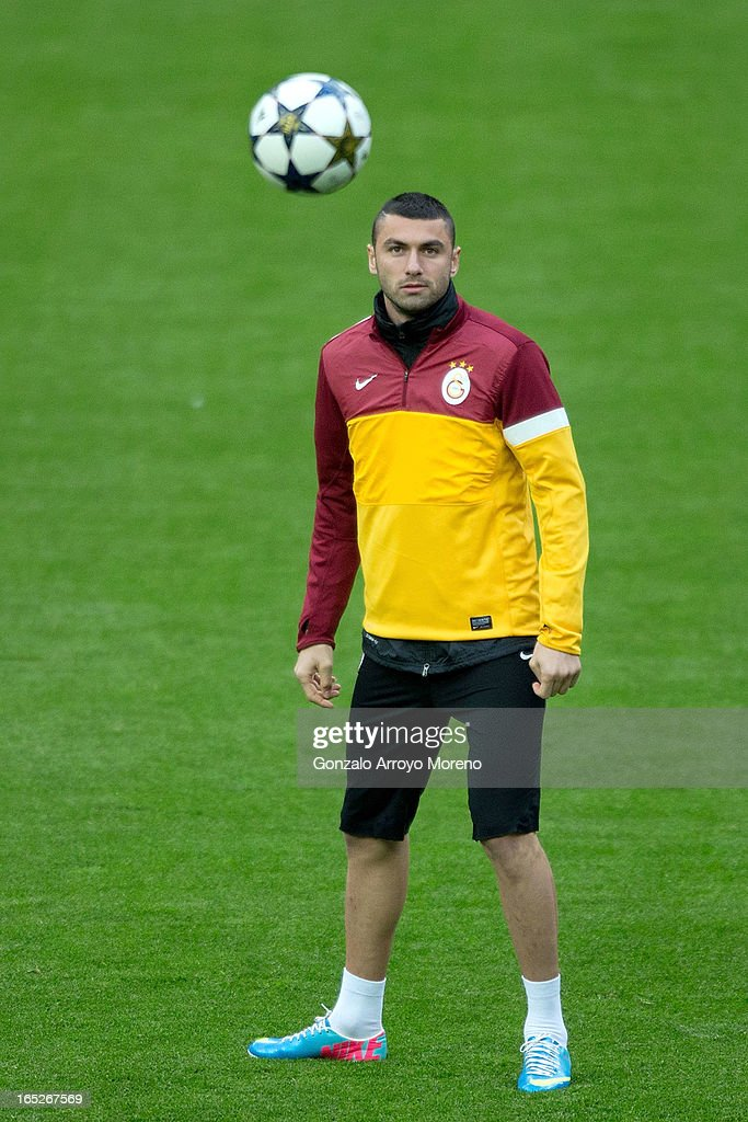 <a gi-track='captionPersonalityLinkClicked' href=/galleries/search?phrase=Burak+Yilmaz&family=editorial&specificpeople=8254293 ng-click='$event.stopPropagation()'>Burak Yilmaz</a> looks the ball during a training session ahead of the UEFA Champions League Quarterfinal match between Real Madrid and Galatasaray AS at Estadio Santiago Bernabeu on April 2, 2013 in Madrid, Spain.