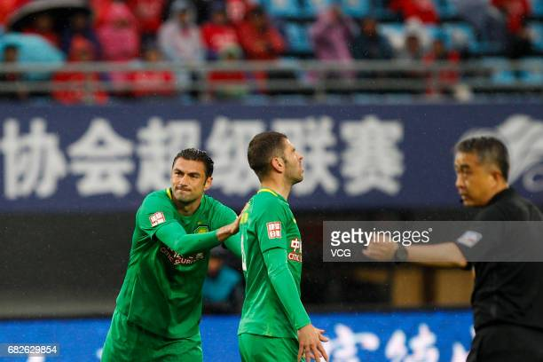 Burak Yilmaz of Beijing Guoan and Jonathan Soriano of Beijing Guoan react during the 9th round match of 2017 Chinese Football Association Super...