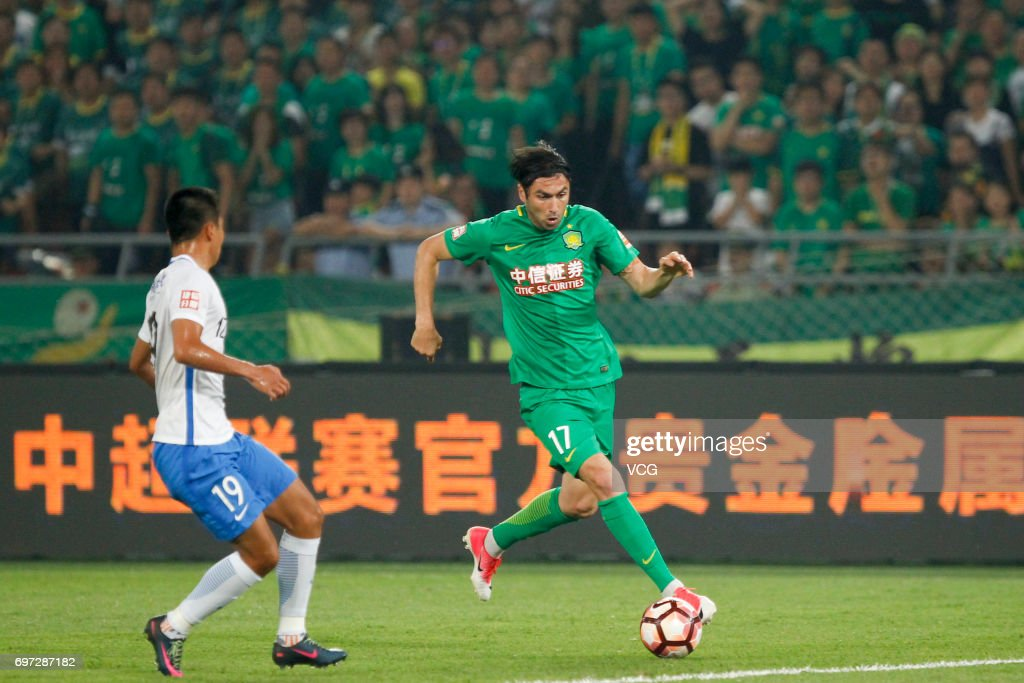 Burak Yilmaz # 17 of Beijing Guoan follows the ball during the 13th round match of 2017 Chinese Football Association Super League (CSL) between Beijing Guoan and Tianjin Teda at Beijing Workers' Stadium on June 18, 2017 in Beijing, China.