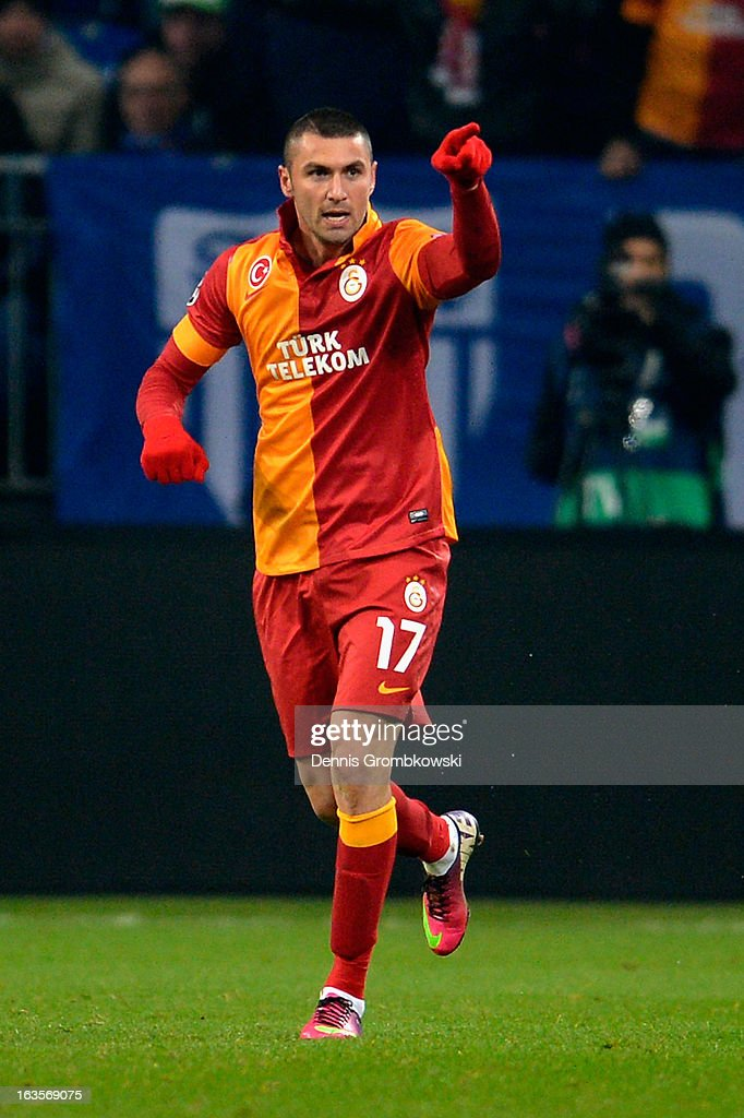 <a gi-track='captionPersonalityLinkClicked' href=/galleries/search?phrase=Burak+Yilmaz&family=editorial&specificpeople=8254293 ng-click='$event.stopPropagation()'>Burak Yilmaz</a> of Galatasaray celebrates after scoring his team's second goal during the UEFA Champions League round of 16 second leg match between Schalke 04 and Galatasaray AS at Veltins-Arena on March 12, 2013 in Gelsenkirchen, Germany.