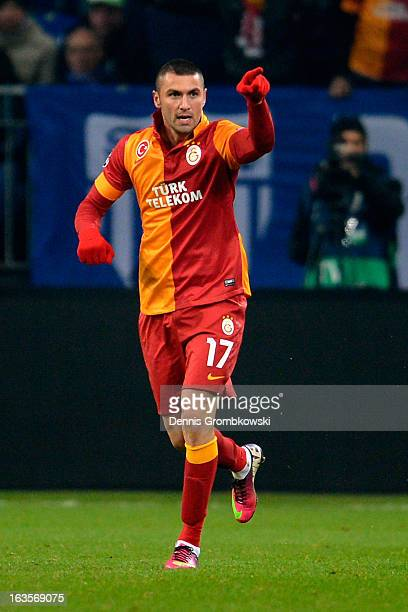 Burak Yilmaz of Galatasaray celebrates after scoring his team's second goal during the UEFA Champions League round of 16 second leg match between...