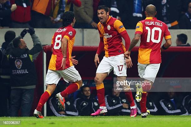 Burak Yilmaz of Galatasaray celebrates his team's first goal with team mates Selcuk Inan and Felipe Melo during the UEFA Champions League Round of 16...