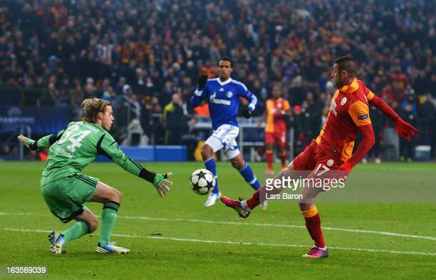 Burak Yilmaz of Galatasaray scores his teams second goal during the UEFA Champions League round of 16 second leg match between FC Schalke 04 and...