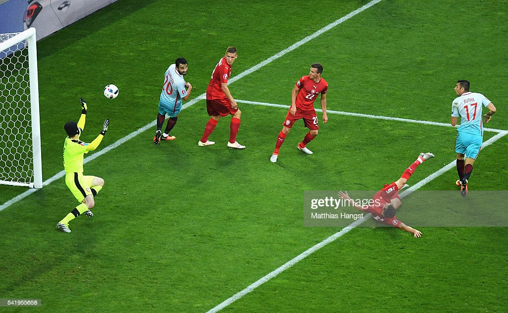 <a gi-track='captionPersonalityLinkClicked' href=/galleries/search?phrase=Burak+Yilmaz&family=editorial&specificpeople=8254293 ng-click='$event.stopPropagation()'>Burak Yilmaz</a> of Turkey scores his team's first goal during the UEFA EURO 2016 Group D match between Czech Republic and Turkey at Stade Bollaert-Delelis on June 21, 2016 in Lens, France.