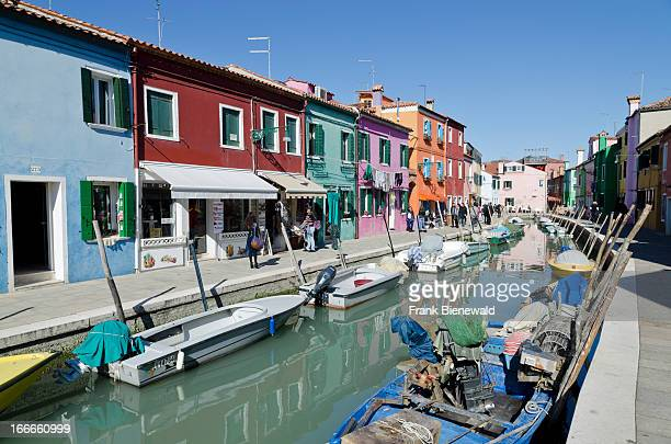 Burano one of the little islands closed to Venice attracts tourists by it's colorfully painted houses