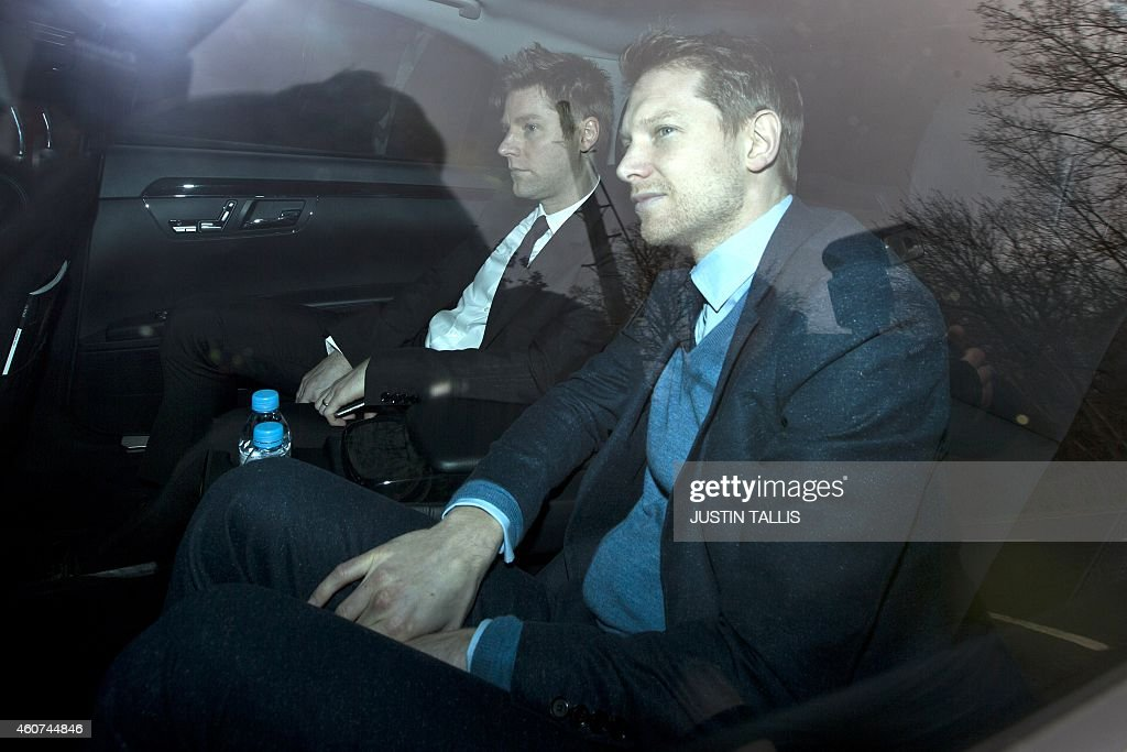 BUrberry CEO Christopher Bailey and his partner English actor Simon Woods arrive to attend British pop legend Elton John's wedding to his partner...