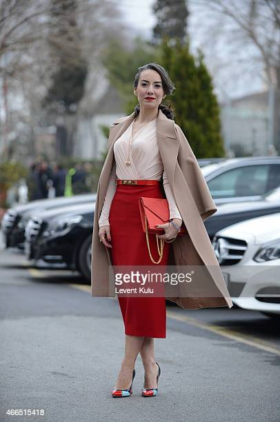Burcin Unaldi poses wearing a dress by Gulnur Gunes shoes by Ayakkabi Dunyasi and a hang bag by Chuchu during Mercedes Benz Fashion Week Istanbul...