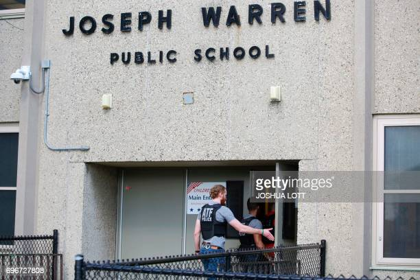 A Bureau of Alcohol Tobacco Firearms agents and a Chicago Police officer enter Warren Elementary School where two girls 7 and 13 were shot during a...