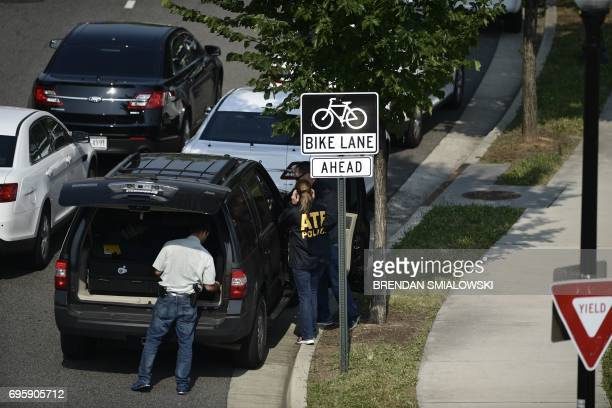 Bureau of Alcohol Tobacco Firearms and Explosive members gather near the crime scene of an early morning shooting in Alexandria Virginia June 14 2017...