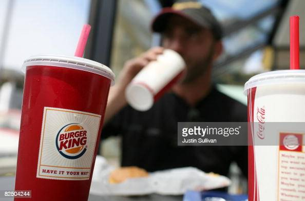 Burger King customer drinks a soda while eating lunch at a Burger King restaurant August 21 2008 in San Francisco California Burger King the second...