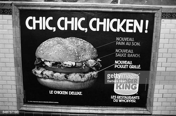 A Burger King poster advertising the 'Le Chicken Deluxe' chicken sandwich on the Metro Paris France July 1991